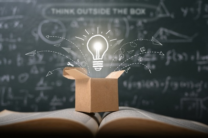 think outside the box on school green blackboard . startup  education concept. creative idea. leadership.
